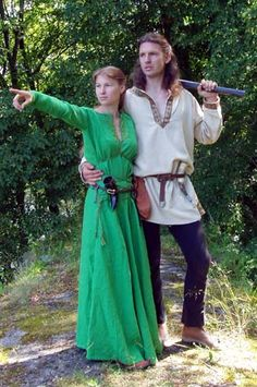 Viking couple     green linen and beige tunics. Early Middle Ages. Author - Misa.