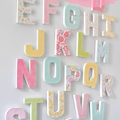 DIY Letter Wall - Make a big, colorful statement piece with an inexpensive home decor craft. {The Love Nerds} #letterdecor #modpodge #papermache #papercraft