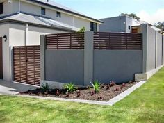 Concrete and wood fence
