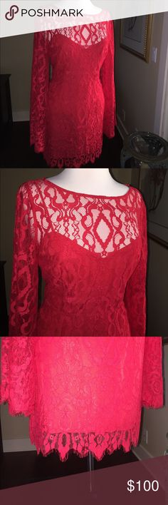 Gorg! FREE PEOPLE Stretch Lace Dress Perfect holiday party dress! Special details of the stretch lace dress include bell sleeves, keyhole in back with lace covered button closure. The under slip has a sweetheart neckline and super sexy low cut back. Crimson Red. You'll be sure to be the bell of any ball in the beauty. And you'll be comfortable all night long! Was purchased this year to wear to Valentines dinner with my guy but wasn't well enough to go. Still has the tags. Excellent…