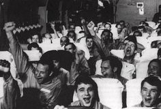 POWs after just being released from the Hanoi Hilton and passed into US custody celebrate.