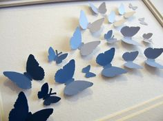 Can't be that hard to make.. Have a butterfly cut out from a paint chip then bend at the wing