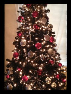 Black Christmas tree, hot pink & silver bulbs and gift wrap