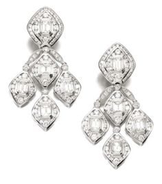 This is a fine pair of diamond earrings signed by Repossi.