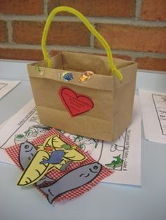 5 loaves/2 fishes craft - lunch sacks cut down, pipe cleaners, bread and fish for them to color