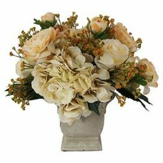 """Faux ranunculus, rose, and hydrangea arrangement with baby's breath accents in a stone pot.  Product: Faux floral arrangementConstruction Material: Silk, plastic, and stoneColor: Peach, creme, and greenDimensions: 14"""" H x 16"""" Diameter"""