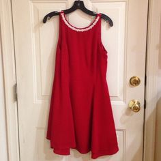 Lady in red dress Red scoop neck dress with pearl detail neckline.  Size 6. This could be your holiday dress.   If anyone is interested I'll lower the price to get you cheaper shipping  CDC Dresses Midi