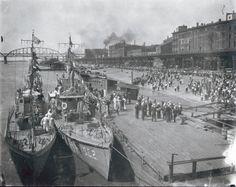 Crowd on riverfront greeting U.S. Navy anti-submarine flotilla for demonstration visit. 13 June 1919. Missouri History Museum