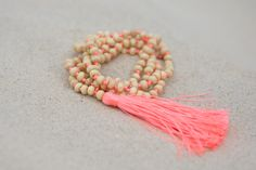 Cable Beach Tassel Necklace. S A L T | W A T E R  The cure for anything is salt water: sweat, tears or the sea.  Cable Beach of Western Australia features pure white beaches as far as the eye can see, and our stunning 'Cable Beach' accessories match the beautiful sand dunes. On trend neon tassels add something special to your outfit, and all items are designed to layer and stack to add extra oomph. What makes these gorgeous Ruby & Lilli necklaces special is the additional length…