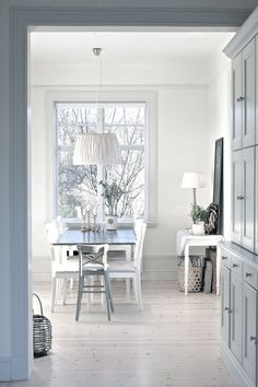 Pale blue/grey and white dining room