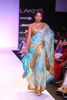 Mandira Bedi Lakme Fashion Week Summer 2014 blue tie die and gold sari. More here: http://www.indianweddingsite.com/mandira-bedi-lakme-fashion-week-summer-resort-2014/
