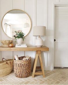 Neutral decor with round mirror perfect for an entry way