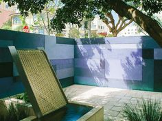Colored slab walls are a key element in small garden space. A wall or fence in a garden is made from a variety of materials, brick being the most popular, followed closely by concrete, wood, and metal. Material should blend with setting.