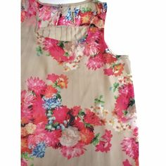 Floral High-Low Top Bright, girly floral sheer tank. High-low. Pleated back. Gold button detail. Some pulling on the back shown in photos. Can't find the size on it but I think it was listed as S or M when bought- fits semi loose so probably a M Tops Blouses