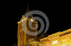 Night shot of a vintage clock tower.