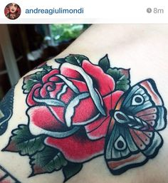 Traditional rose and butterfly tattoo on shoulder
