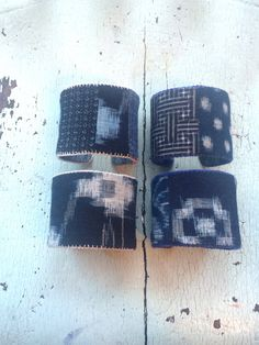 Ive lined these 2 adjustable cuffs with vintage indigo Kasuri prints and edged them with embroidery thread. Light and comfortable to wear, they easily bend to fit any wrist. Please specify which cuff(s) you are choosing. My handmade cuffs arrive in cloth drawstring gift bags.