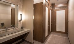 Ironwood Manufacturing wood veneer toilet partition and bathroom doors with Door Lite insert. Beautiful, unique and upscale toilet restroom stalls.