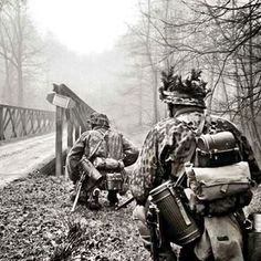 Waffen SS soldiers, near a bridge.
