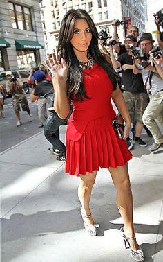 Kim Kardashian clad in a sexy scarlet Alexander McQueen minidress, Christian Louboutin snakeskin heels and a full-face of makeup