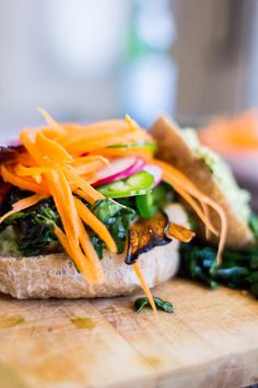 Prepare yourself for the best veggie sandwich EVER!! Crispy eggplant bacon, marinated artichoke hearts, sultry kale salad and crunchy fresh veggies. So easy, so good!