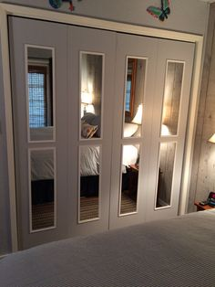 Bifold closet doors transformed into mirrored French doors - these are actually MY doors after using great ideas found on Pinterest. I love the change and I can now access the dark reaches of my formerly messy closet!