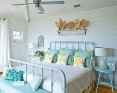 Love the whitewash walls and exposed white ceiling with pops of turquoise