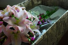 Cascade bouquet with lilies, lisianthus and freesia.
