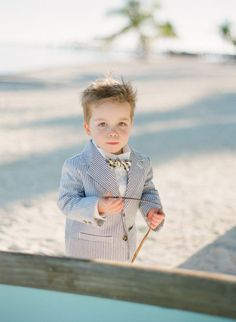 little ring bearer in seersucker  Photography by KT Merry Photography / ktmerry.com
