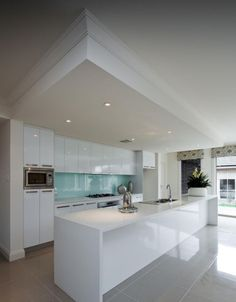 Love the dropped ceiling, blue glass splashback and tonnes of cupboards Most Popular Kitchen Design Ideas on 2018 & How to Remodeling Grey Flooring, House Design, Kitchen Flooring, Kitchen Ceiling, White Kitchen Cupboards, Modern Kitchen, Glass Kitchen, Grey Kitchen Floor, Kitchen Design