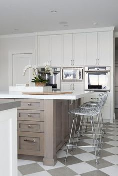 Grey white checkerboard kitchen floor wood finish island