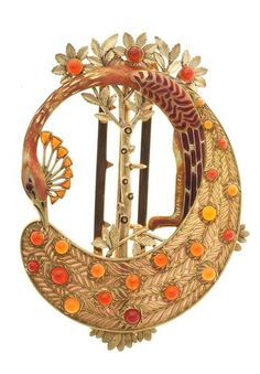 Belt Buckle | Eugène Grasset. Enamelled gold accented with carnelian cabochon. ca. 1900. {Would make a great brooch}