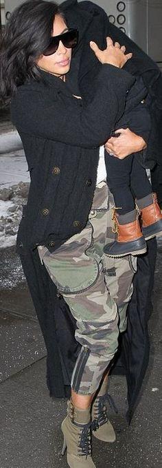 Kim Kardashian, black sunglasses, cardigan sweater, camo green pants