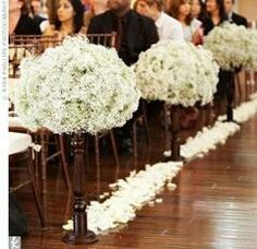 Hydrangea aisle end floor arrangements.  Could do with million star too.