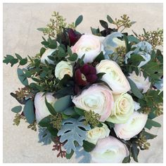 Bridal bouquet with rananculus and heliborous