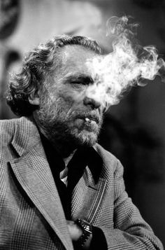 Writer Charles Bukowski with his most famous trademark: The cigarette.