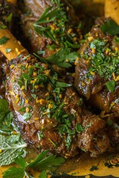 Persian-Spiced Lamb Shanks Recipe - NYT Cooking [meaty lamb shanks, cinnamon, nutmeg, cardamom, dried rosebuds (optional), turmeric, saffron, lime juice, rosewater, ground dried lime or the zest of 1 fresh lime, orange zest, bay leaves + parsley and mint for garnish]