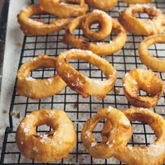 You don't need fancy equipment to make awesome onion rings—just a knife, a heavy saucepan, a thermometer and a mesh skimmer. If you don't have a metal rack for cooling, drain the onion rings on bro...