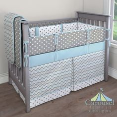 Crib bedding in Solid Mist, Mist and Gray Chevron, White and Gray Polka Dot, Gray and White Polka Dot. Created using the Nursery Designer® by Carousel Designs where you mix and match from hundreds of fabrics to create your own unique baby bedding.