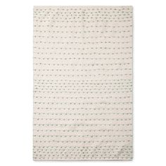 "Create comfort and beauty in a room with the Woven Accent Rug (30""x48"") Mint & White from Pillowfort. This area rug has a white background and adds interest with the mint polka dots."
