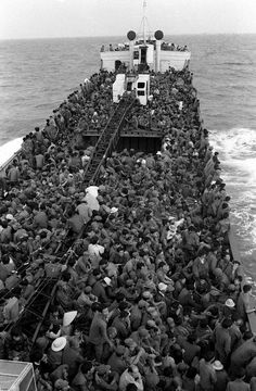 South Vietnamese troops fill every available space on a ship evacuating them from Thuan An beach, near Hue, to Da Nang as Communist troops advanced in March, 1975.