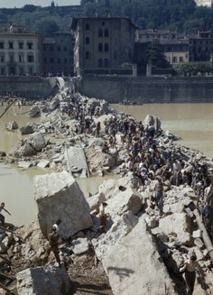 Once Upon a Time in War: Civilians clambering over the ruins of the Ponte Alle Grazia, one of the bridges over the River Arno destroyed by the Germans before evacuating Florence/August 1944.