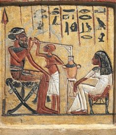 Ancient Egyptians drinking beer, circa 1350 BC.