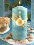 oceanic pillar candle displayed on sea shell candle plate