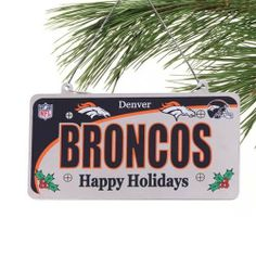 """Denver Broncos Team Ornament by Forever Collectibles. $12.99. Add a touch of some festive Broncos pride to your holiday tree this December with this metal License Plate ornament and let your team spirit guide you through the holidays! Featuring printed graphics such as a bold team name that'll be visible from any corner of your room, team logos, a team helmet, mistletoe and """"Happy Holidays"""" lettering-all layered over a smooth, chrome surface-this metal ornament will surely l..."""