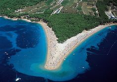 Zlatni Rat in Croatia is a beach with pebbles so white you'd think from a distance the entire area was made up of find sand. However, this spot on Brac island Amazing Destinations, Holiday Destinations, Les Balkans, Costa, Croatian Islands, Famous Beaches, Hidden Beach, Beaches In The World, Beach Fun