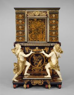 Cabinet on Stand; Attributed to André-Charles Boulle (French, 1642 - 1732, master before 1666), and medallions after Jean Varin (French, 1596 - 1672); Paris, France; about 1675 - 1680; Oak veneered with pewter, brass, tortoise shell, horn, ebony, ivory, and wood marquetry; bronze mounts; figures of painted and gilded oak; with drawers of snakewood.