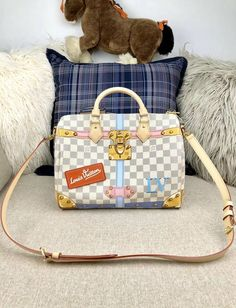 f4b9620034ac Louis Vuitton Damier Azur Canvas Speedy 30 Fashioned in Damier Azur coated  canvas and leather patches adorned with trompe l oeil screen prints of  trunk ...