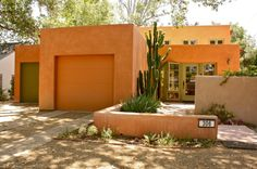 Against the brightly colored adobe walls, this contemporary residence needs only the native plants to make a statement. In this case, even the plantings are minimal, serving as accent pieces, while the architecture takes center stage. This landscape is also a good reflection of the realities of living in the Southwest — water is scarce and should be used wisely.  mediterranean exterior by Shannon Malone