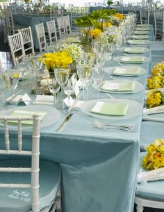 Yellow themed centerpieces. Using different flowersand heights for each arrangement adds wonderful interest.